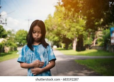 Portrait of a homeless asian girl