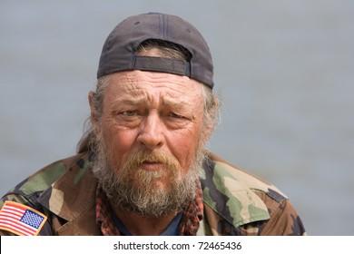 Portrait of homeless man with beard