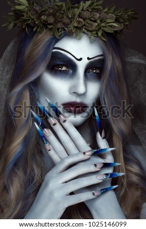 Portrait of a horrible scary Corpse Bride in wreath with dead flowers, halloween makeup and