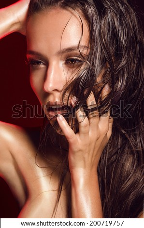 Portrait Of Hot Girls With Dark Hair Tanned Shiny Skin Wet In Oil