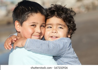 portrait of hugging little brothers