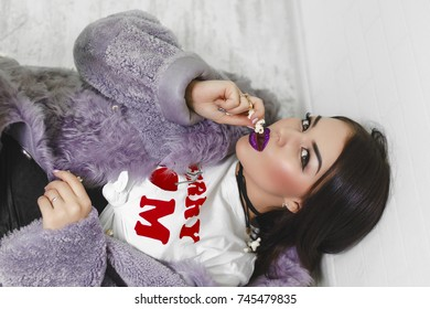 Portrait of hungry young cheeky girl eating popcorn