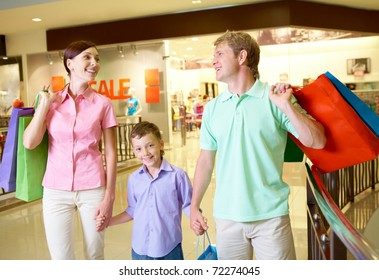 Portrait of husband and wife with their son after shopping