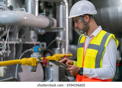 Portrait of HVAC engineer working in boiler room, Engineer working in gas boiler room for steam production of factory industrial manufactured, working in the boiler room, maintenance concept