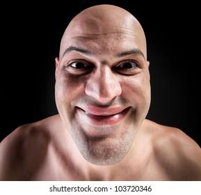 Portrait of idiotic andcrazy bald man