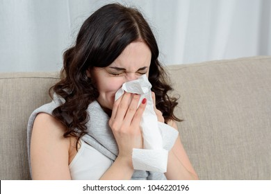 Portrait Of Ill Woman Caught Cold, Feeling Sick And Sneezing In Paper Wipe