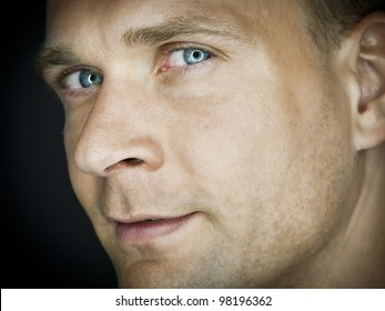 A portrait image of an attractive male with blue eyes