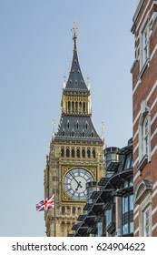 A portrait image of Big Ben and a Union Jack flag flying on April 8th 2017 in Westminster, London, UK