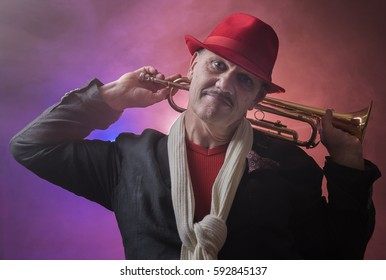 Portrait image of a happy mature jazz man with a trumpet