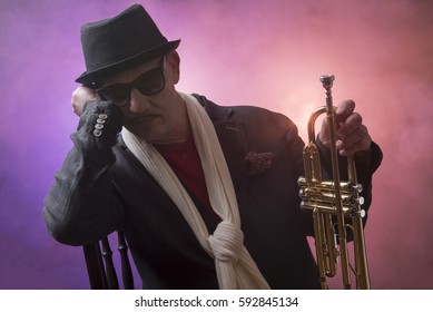 Portrait image of a mature jazz man with a trumpet