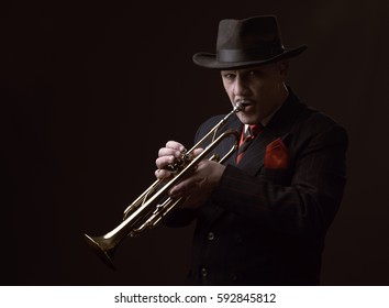 Portrait image of a mature jazz man playing the trumpet