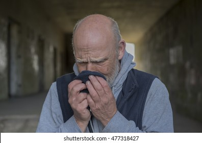 Portrait image of a mature man upset and crying