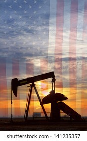 Portrait image of a oil well pumpjack wiith an early morning golden sunrise and American USA red White and Blue Flag background.