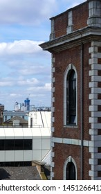 Portrait image with a Victorian brick built tower and a view across the Borough of Southwark. London. High rise in distance. Summertime with blue skyline an high rise buildings in distance. England.