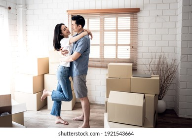 Portrait images of Asian couple , They hug each other and happy, because of the joy of moving to a new home together relocation, to people and family concept.