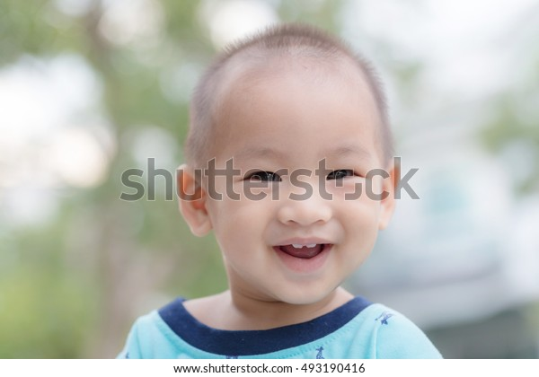 Portrait of incredibly cute little boy and background blur.