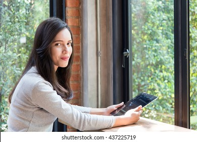 Portrait of  Indian / Asian college student with tablet computer.