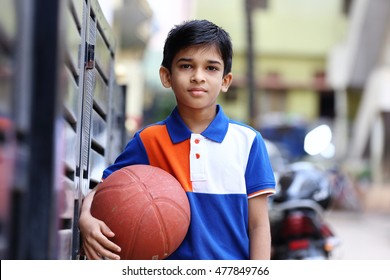 Portrait of indian boy with Basketball