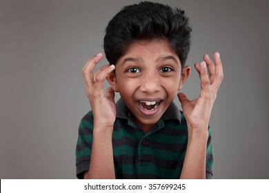 Portrait of an Indian boy cheering up