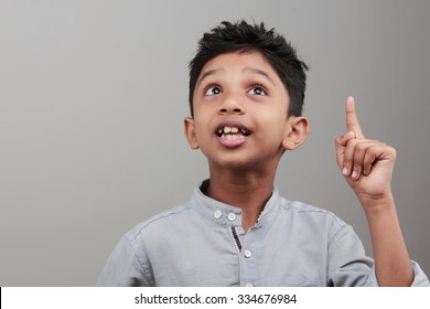 Portrait of an Indian boy with an expression when he gets an idea or solution