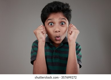 Portrait of an Indian boy with a surprise expression