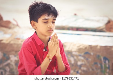 Portrait of Indian Cute Boy Praying