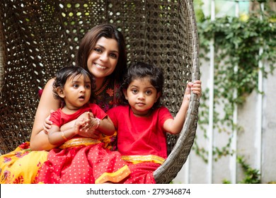 Portrait of Indian family of mother and two daughters