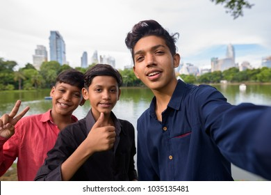 Portrait of Indian family relaxing together at the park in the city of Bangkok, Thailand