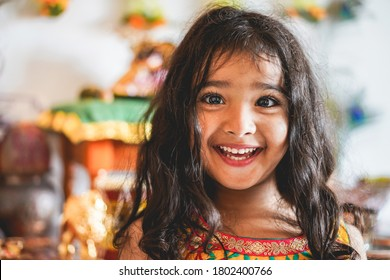 Portrait of indian female kid wearing sari dress - Southern asian child having fun smiling in front of camera - Childhood, different cultures and lifestyle concept