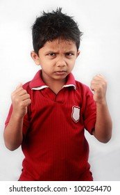Portrait of Indian kid with ready to fight attitude