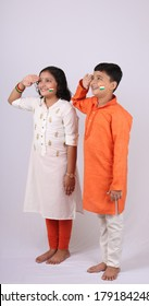 Portrait of Indian kids saluting. over white background