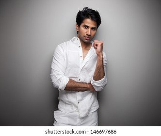 Portrait of an Indian man wearing white clothes