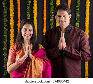 Portrait of Indian Married couple in traditional wear in Namaskara /prayer / welcoming pose