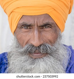 Portrait of Indian sikh man in turban with bushy beard. Amritsar, India