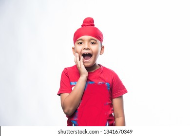 c1dba016 Portrait of Indian Sikh/punjabi little boy with multiple expressions.  isolated over white background