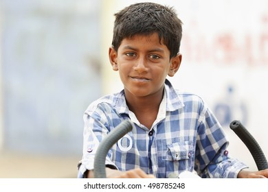 Portrait of Indian Young Boy with bicycle