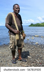 Portrait of Indigenous Fijian fisherman going fishing from a beach in Vanua Levu, Fiji. Real people. copy space. Vertical