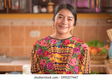 Portrait of an indigenous woman looking at camera smiling and happy.