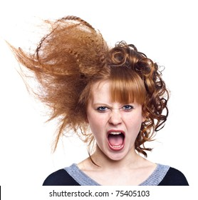 Portrait of the indignant young woman on the isolated white background.Strange hairdress. Anger
