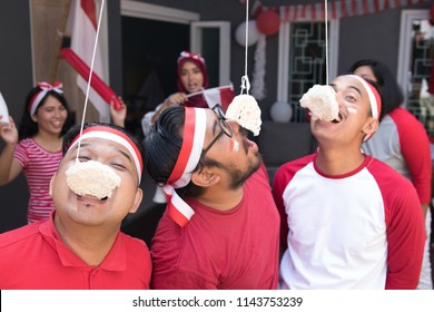portrait of indonesia crackers eating competition on independence day celebration