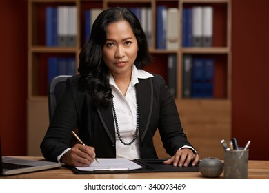 Portrait of Indonesian female lawyer at her workplace
