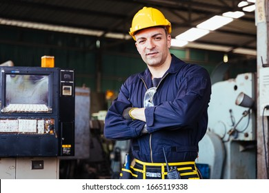 Portrait of Industry factory maintenance engineer wearing uniform and safety helmet. Industry, Engineer, construction concept.
