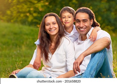 Portrait of an international family sitting together in the park