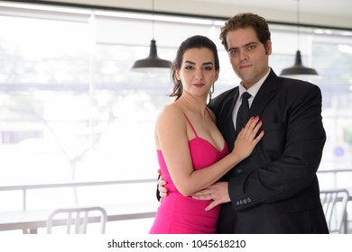 Portrait of Iranian couple relaxing together at home