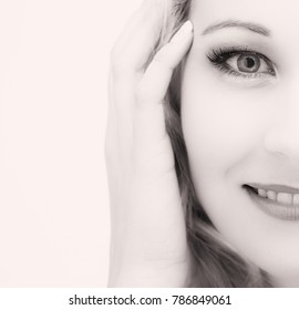 Portrait of an isolated friendly blond woman in a high key artistic conversion