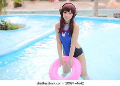 portrait of Japan anime cosplay girl with swim suit at swimming pool