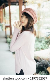 Portrait japanese fasion style wool coat fashion dress in japanese garden