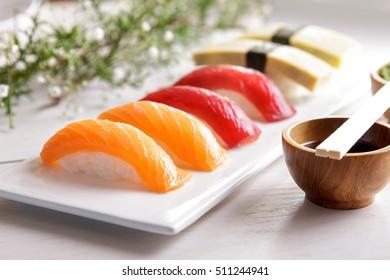 portrait of japanese food nigiri sushi sets on white plate