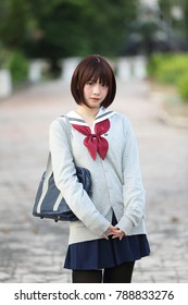 Portrait of Japanese school girl with countryside park