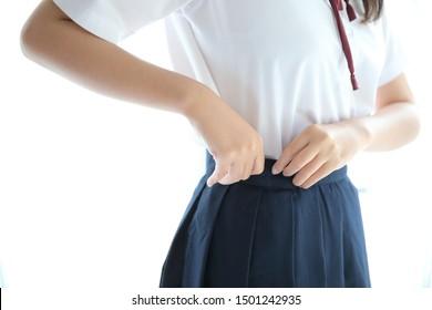 Portrait japanese school girl dressing in white tone bed room